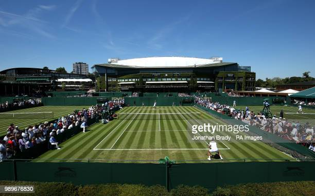 A general view of the match action between Sergiy Stakhovsky and Joao Sousa on day One of the Wimbledon Championships at the All England Lawn Tennis...