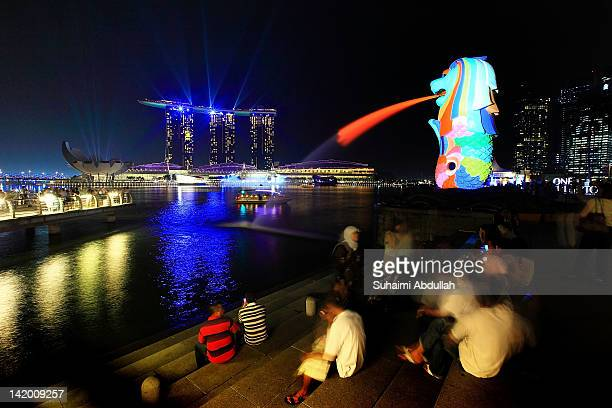 A general view of the Merlion Marina Bay Sands and the city skyline on March 28 2012 in Singapore Singapore expects a slowdown in tourist arrival...