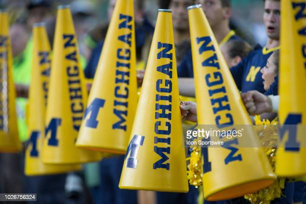 A general view of the Michigan cheerleader's megaphones is seen on the sideline during game action between the Michigan Wolverines and the Notre Dame...
