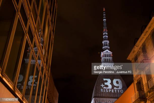 A general view of the Mole Antonelliana illuminated in honour of the victims of the Heysel Stadium disaster on May 29 2019 in Turin Italy On May 29...