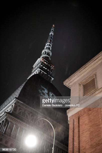 A general view of the Mole Antonelliana illuminated in honour of the victims of the Heysel Stadium disaster on May 29 2018 in Turin Italy On May 29...
