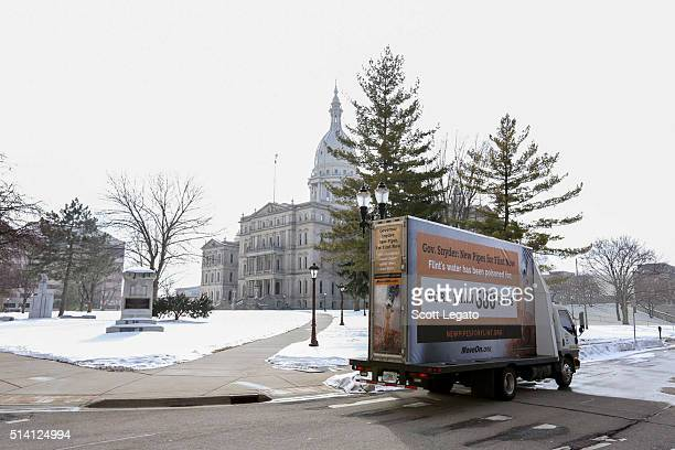 General view of the MoveOnorg mobile billboard drives and parks by the Michigan State Capitol Building on March 6 2016 in Lansing MI