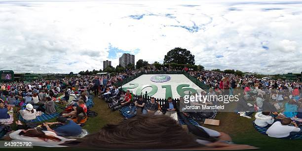 A general view of the Murray mound as people watch Andy Murray of Great Britain during the Men's Singles second round match against YenHsun Lu of...