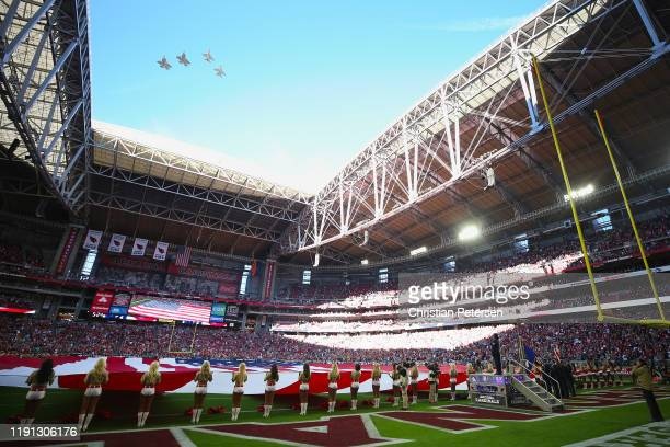General view of the national anthem as the Air Force perform a fly-over before NFL game between the Arizona Cardinals and the Los Angeles Rams at...