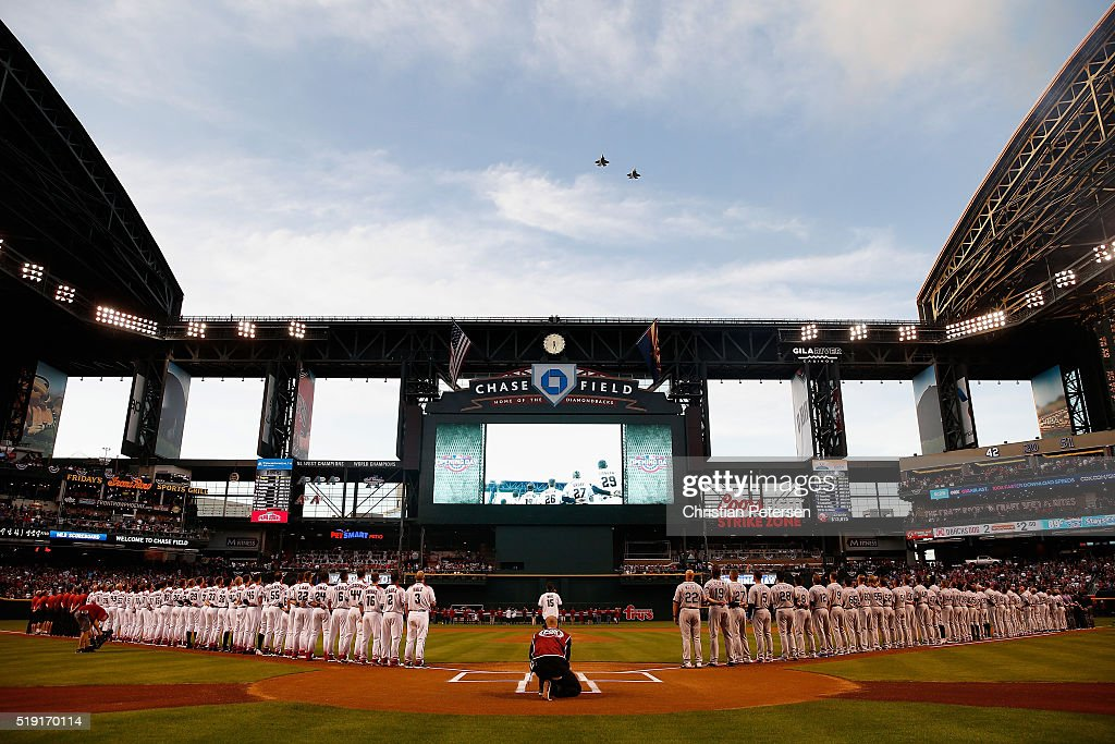 General view of the national anthem as the Arizona Diamondbacks and Colorado Rockies stand attended before the MLB opening day game at Chase Field on April 4, 2016 in Phoenix, Arizona.