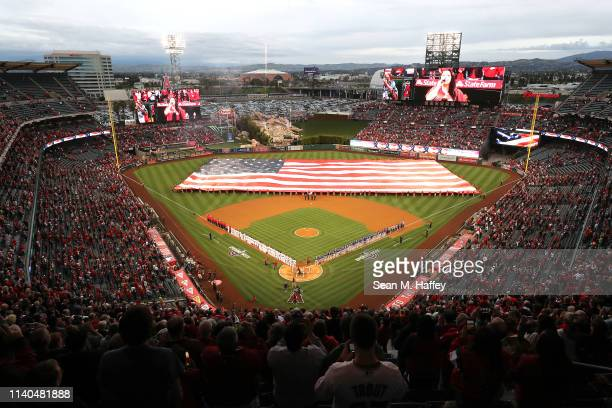 A general view of the national anthem prior to the home opener between the Los Angeles Angels of Anaheim and the Texas Rangers at Angel Stadium of...