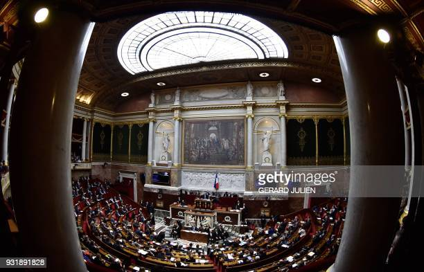 A general view of the National Assembly taken during a session of questions to the government in Paris on March 14 2018 / AFP PHOTO / GERARD JULIEN