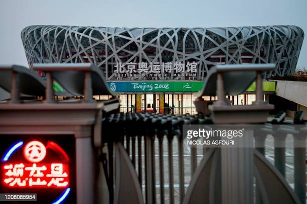 General view of the national 'Birds Nest' stadium , the site of the 2008 Beijing Olympics, in Beijing on March 24, 2020. - The 2020 Tokyo Olympics...