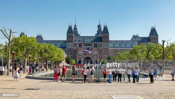General view of the National Museum from the Museumplein Square on May 28 2018 in Amsterdam Netherlands The 'I amsterdam' sign is a wellknown tourist...