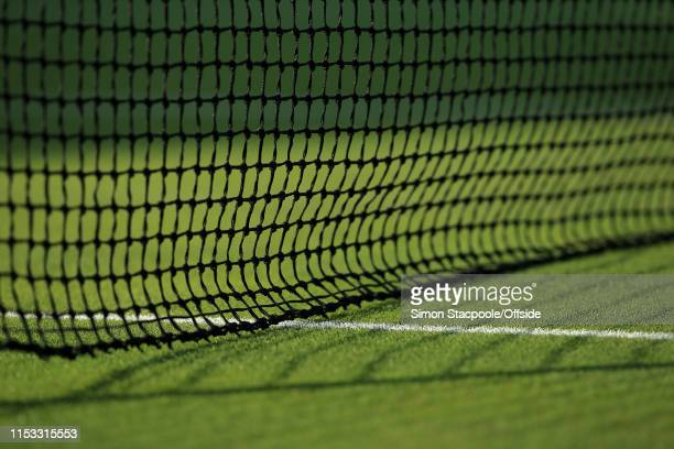 A general view of the net and shadows during Day 2 of The Championships Wimbledon 2019 at the All England Lawn Tennis and Croquet Club on July 2 2019...