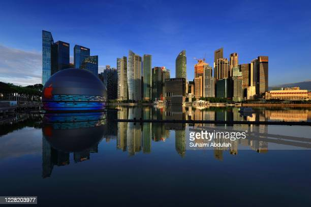 General view of the new Apple flagship store against the city skyline at Marina Bay Sands waterfront on August 26, 2020 in Singapore. The store...