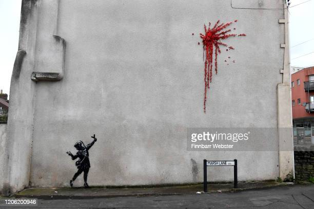 General view of the new Banksy art on February 14, 2020 in Bristol, England. The artwork of a girl firing flowers into the air appeared on the wall...