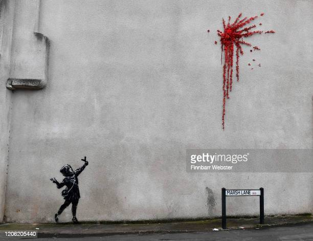 A general view of the new Banksy art on February 14 2020 in Bristol England The artwork of a girl firing flowers into the air appeared on the wall of...
