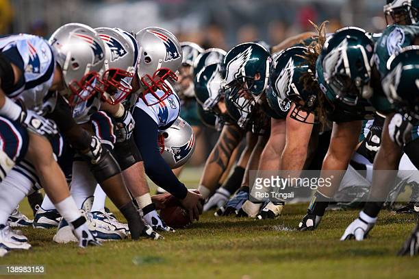 A general view of the New England Patriots and the Philadelphia Eagles at the line of scrimmage during the came between the two teams at Lincoln...