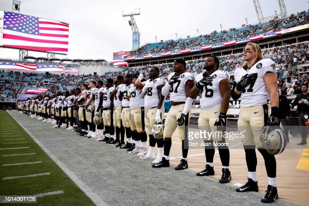 A general view of the New Orleans Saints on the sidelines during the National Anthem before the start of a preseason game against the Jacksonville...