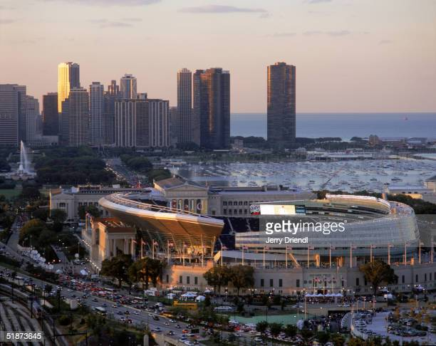 General view of the New Soldier Field Stadium with the Chicago skyline background filed with a warm light from the sun prior to a game between the...