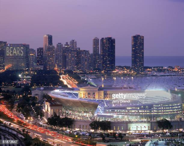 General view of the New Soldier Field Stadium with the Chicago skyline background at dusk prior to a game between the Green Bay Packers and the...