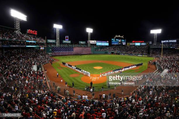 General view of the New York Yankees and the Boston Red Sox as they stand for the national anthem before the American League Wild Card game at Fenway...