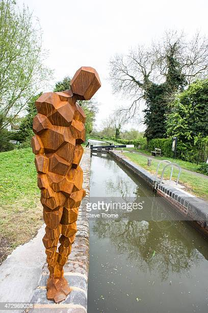 A general view of the newly installed sculpture by artist Anthony Gormley at the Canal Workers Cottage on May 11 2015 in HenleyInArden Warwickshire...