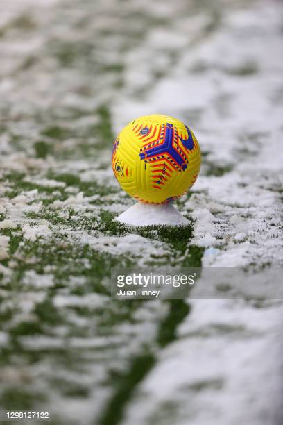 General view of the Nike Flight Premier League match ball placed on a training cone in the snow during The Emirates FA Cup Fourth Round match between...