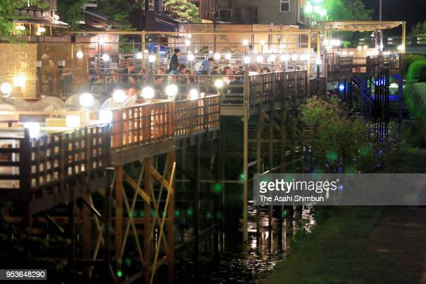A general view of the 'Noryodoko' river terrace restaurants which are open for summer season at Kamogawa River on May 1 2018 in Kyoto Japan