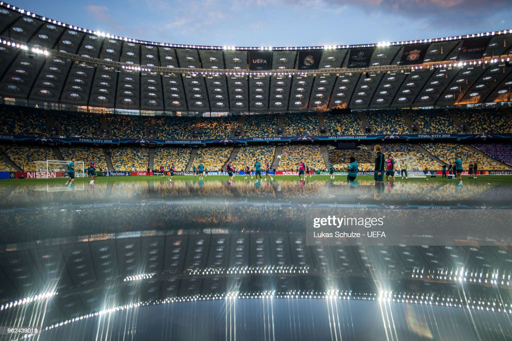 General view of the NSC Olimpiyskiy stadium is reflected in table during a Real Madrid training session ahead of the UEFA Champions League final between Real Madrid and Liverpool on May 25, 2018 in Kiev, Ukraine.