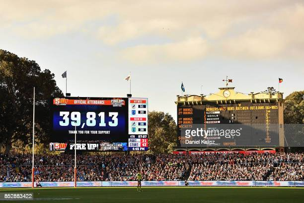 A general view of the old and new scorboard showing the crowd attendance figure during the SANFL Grand Final match between Port Adelaide and Sturt at...