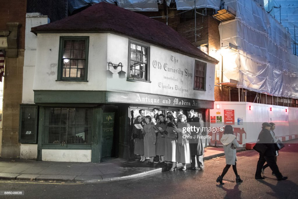 Christmas carols outside the Old Curiosity Shop in Portsmouth Street in 1956 and 2017.