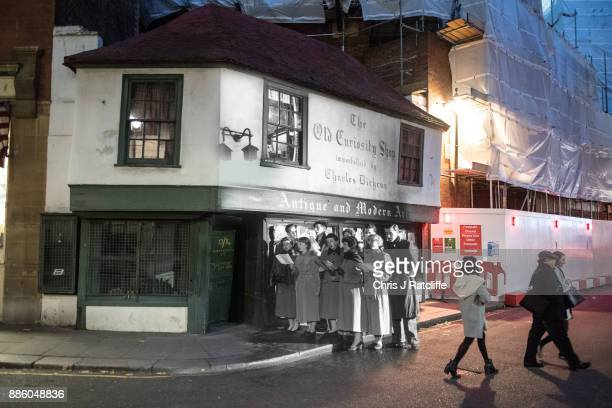 In this digital composite image a comparison has been made of London at Old Curiosity Shop in 1956 and Modern Day 2017 at Christmas time LONDON...