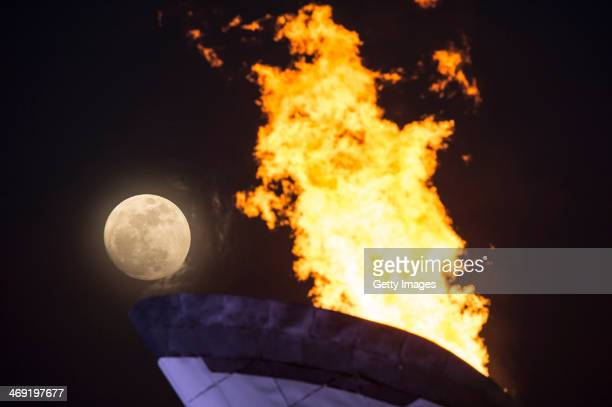 A general view of the Olympic Cauldron and flame with a full moon on day 6 of the Sochi 2014 Winter Olympics at the Olympic Park on February 13 2014...