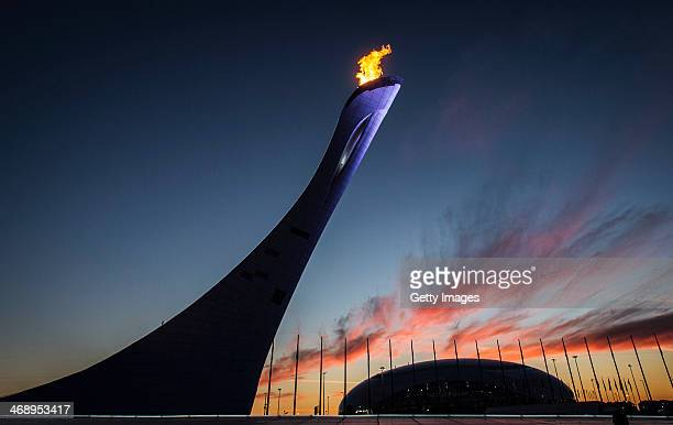 General view of the Olympic Cauldron and flame with the Bolshoy Ice Dome in the distance at sunset during day 5 of the Sochi 2014 Winter Olympics at...