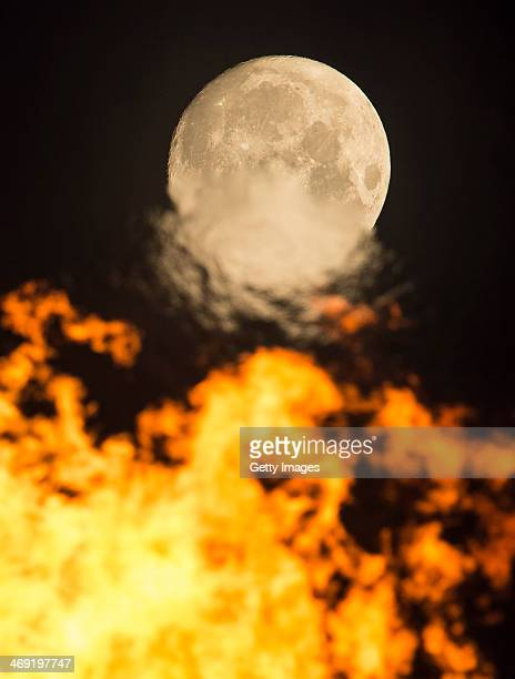 General view of the Olympic Flame with a full moon on day 6 of the Sochi 2014 Winter Olympics at the Olympic Park on February 13, 2014 in Sochi,...