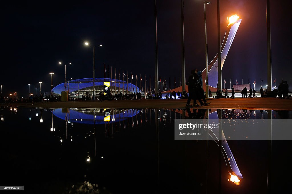 A general view of the Olympic Park with a reflection in a puddle during the Sochi 2014 Winter Olympics on February 17, 2014 in Sochi, Russia.