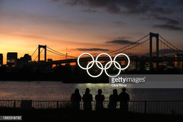 General view of the Olympic rings installation and Rainbow Bridge as the sun sets on day twelve of the Tokyo 2020 Olympic Games at Odaiba Marine Park...