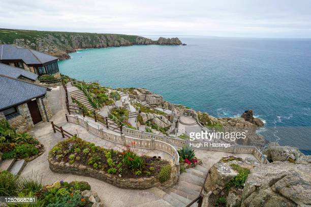 General View of the open air Minack Theatre set in to the cliffs at Porthcurno, on June 26, 2020 in Cornwall, United Kingdom. Actors who work...