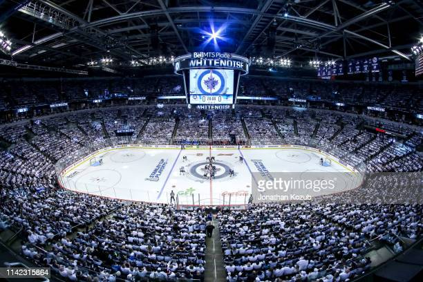 A general view of the opening faceoff between the Winnipeg Jets and the St Louis Blues in Game One of the Western Conference First Round during the...