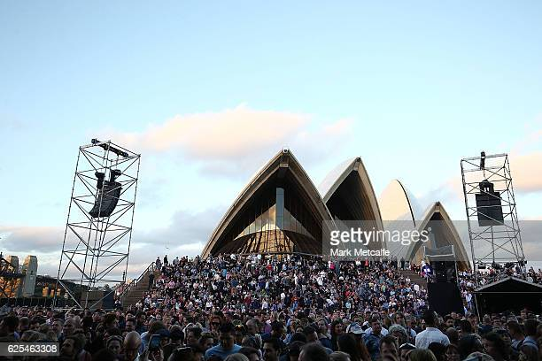A general view of the Opera House forecout and crowd is seen before Crowded House perform on stage during the 'Encore' tour at Sydney Opera House on...