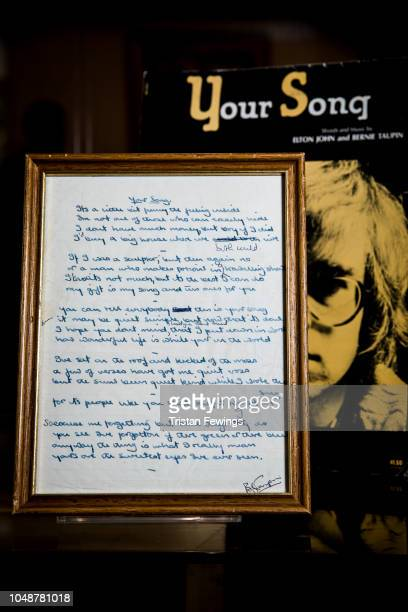 General view of the original handwritten lyrics written by Bernie Taupin to 'Your Song' by Elton John on display at Bonhams on October 10, 2018 in...