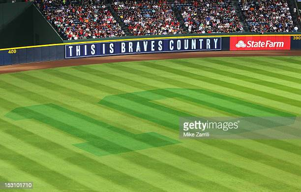 General view of the outfield with a tribute in the grass to third baseman Chipper Jones of the Atlanta Braves during the game between the Atlanta...
