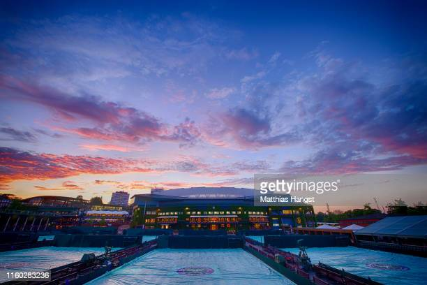 A general view of the outside courts and centre court during Day five of The Championships Wimbledon 2019 at All England Lawn Tennis and Croquet Club...