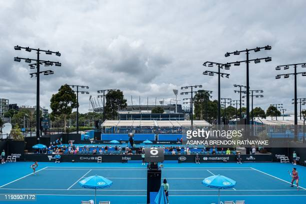 General view of the outside courts at Melbourne Park as dark clouds hover over Melbourne, following a large downpour and thunderstorms overnight in...