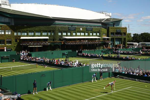 General view of the outside courts with centre court in the background as Camila Giorgi of Italy serves in her Ladies' Singles first round match...