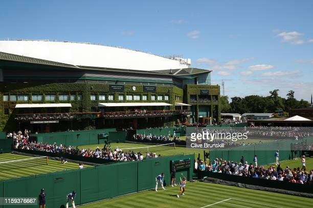 General view of the outside courts with centre court in the background during Day one of The Championships - Wimbledon 2019 at All England Lawn...