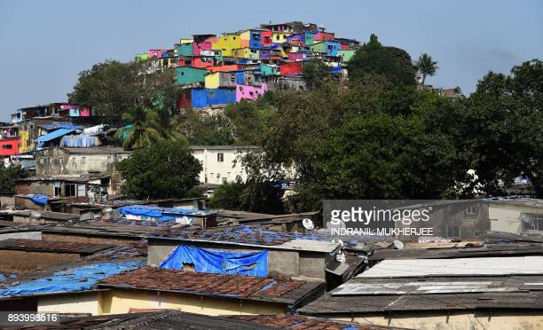 TOPSHOT A general view of the painted walls of the Asalpha village in Mumbai on December 17 2017 With an aim to alter the perspective the world has...
