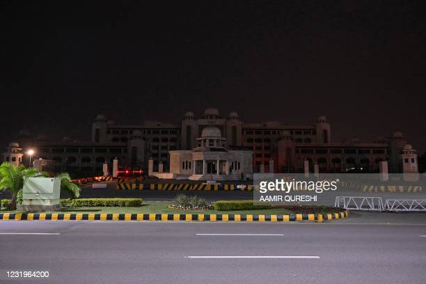 General view of the Pakistan's Prime Minister office building is pictured with its lights switched off during Earth Hour in Islamabad on March 27,...