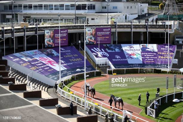 General view of the parade ring before the second race is seen on Day One of the Cheltenham Festival at Cheltenham Racecourse, in Cheltenham, England...