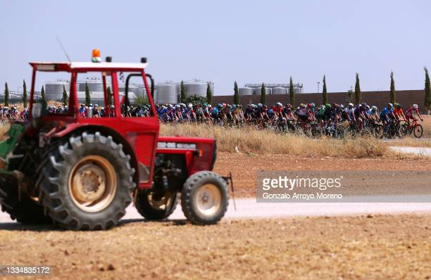 General view of the Peloton passing in front of a tractor during the 76th Tour of Spain 2021, Stage 5 a 184,4km stage from Tarancón to Albacete /...