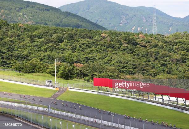 General view of the peloton passing through Fuji International Speedway circuit during the Men's road race on day one of the Tokyo 2020 Olympic Games...