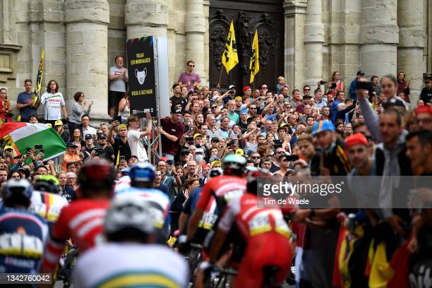 General view of the Peloton passing through Leuven City while fans cheer during the 94th UCI Road World Championships 2021 - Men Elite Road Race a...