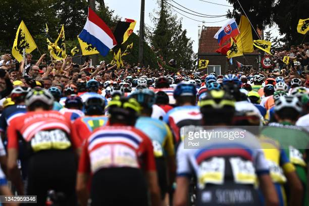 General view of the Peloton passing through Moskesstraat hill while fans cheer during the 94th UCI Road World Championships 2021 - Men Elite Road...